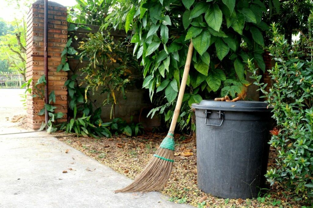 front garden with broom and dustbin